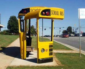 Reuse of school buses into bus shelter. Athens, GA. Created by sculptor Christopher Fennell.